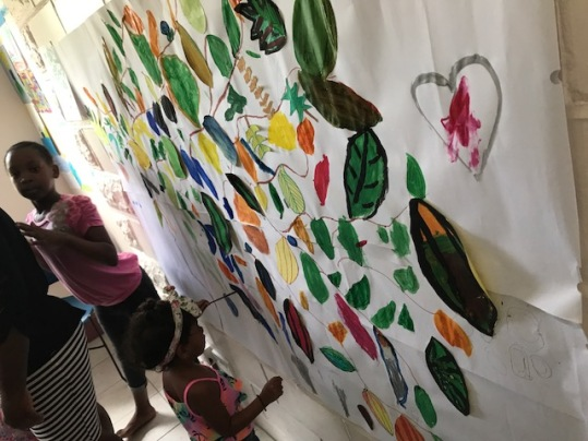 Painting with the children at the Grenada Community Library